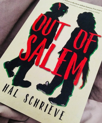 A photo of a physical ARC of Out of Salem by Hal Schrieve on my bed.
