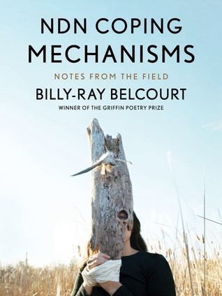 The cover of NSN Coping Mechanisms: Notes from the Field, by Billy-Ray Belcourt. The cover notes that the author is the winnter of the Griffin Poetry Prize. The image is a person with long, dark hair, wearing a black shirt, set against a backdrop of dry, tall grass or wheat, and a pale, clear blue sky. The person has their hands folded as if in prayer in front of them, and the hands are bound together with white fabric. They are holding a piece of wood that looks like a dried, dead tree, with a hole positioned over one of the person's eyes. The wood obscures the rest of the face.
