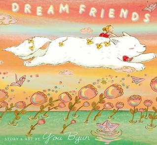 Cover of Dream Friends, by You Byun. The image is of an orange sky over green water with flowers made of bubbles growing out of it. A young girl rides the back of a large white mammal wearing a red bowtie who soars through the sky.