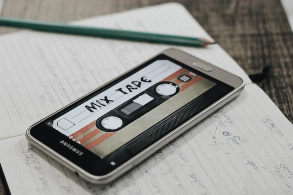 A cell phone displaying an image of an old school mix tape.